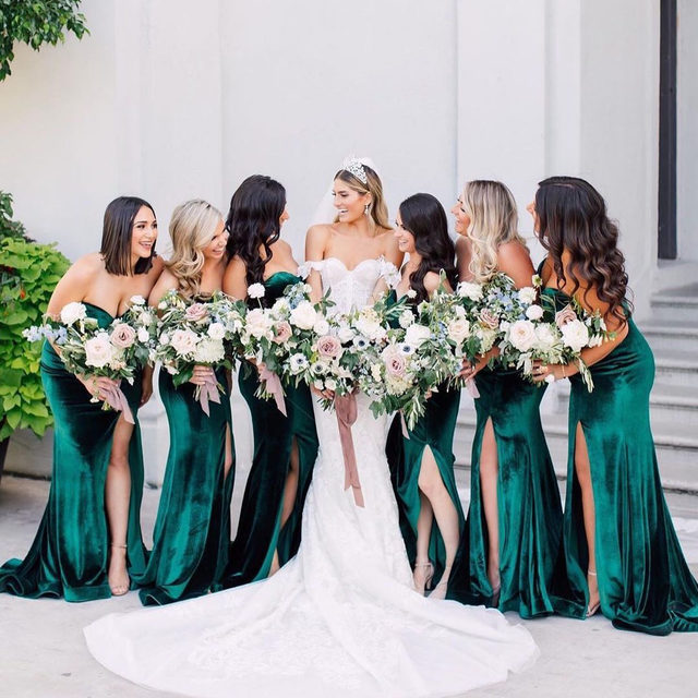 Velvet is having a moment. ❤️ Head to the #linkinbio for 30 trendy bridesmaid dresses under $100! 👯♀️ | 📸: @purpletreephotography 👰🏼: @samanthafarruggioyoga 💐: @huntandgatherfloral