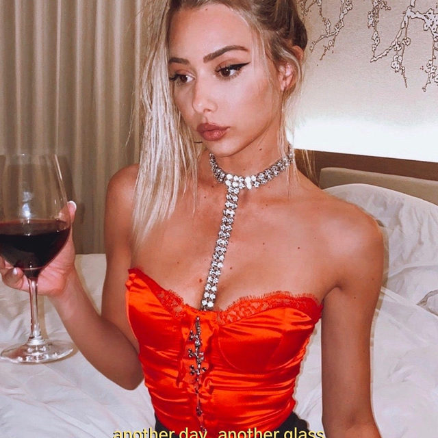 cheers to that 🥂@celestebrightt in the Paris Body Chain - link in bio to shop!  #itsnbd