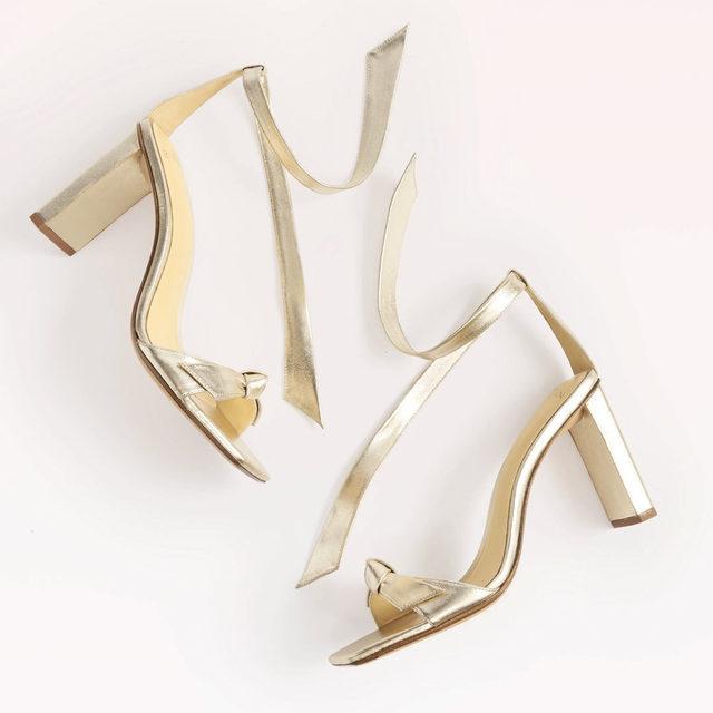 The highest block-heeled rendition of our iconic style Clarita, in standout metallic leather. #AlexandreBirman #Clarita #Sandals