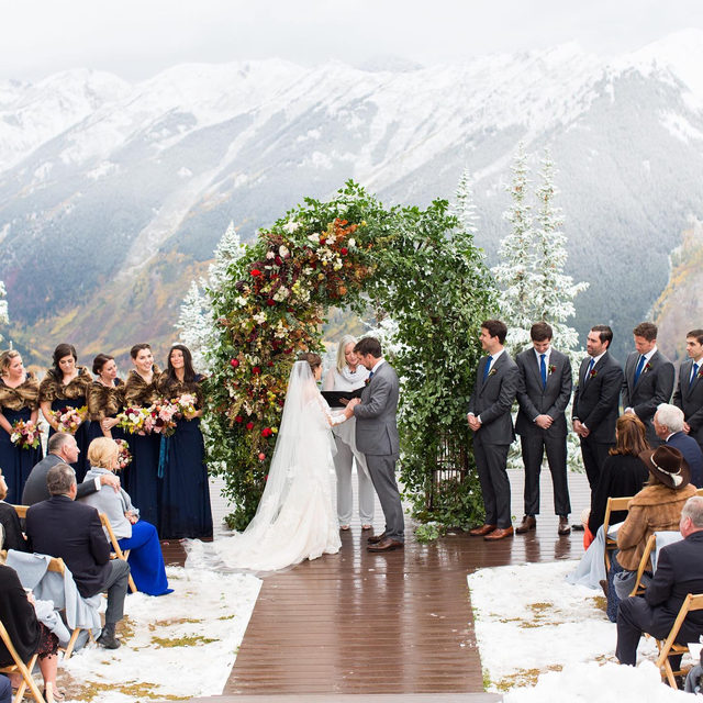 """We'll never get over this snowy wedding and it's partly because this couple said """"I do"""" at the top of a mountain with an elevation of 11,212 feet! ☃️ The rest of the magical reasons you'll have to see for yourself at the #linkinbio. ❄️ #WeddingOfTheDay 