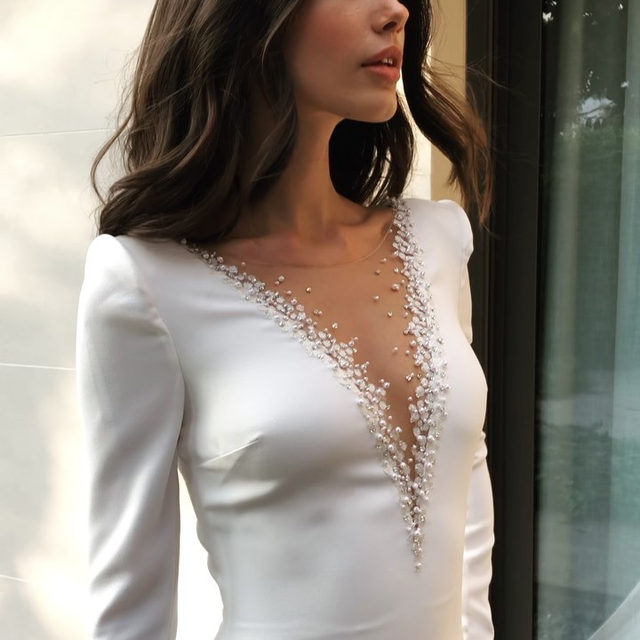 That illusion neckline sprinkled in silver beading! The Elettra dress brings to life the signature mermaid silhouette. Tag a friend who's getting married soon.
