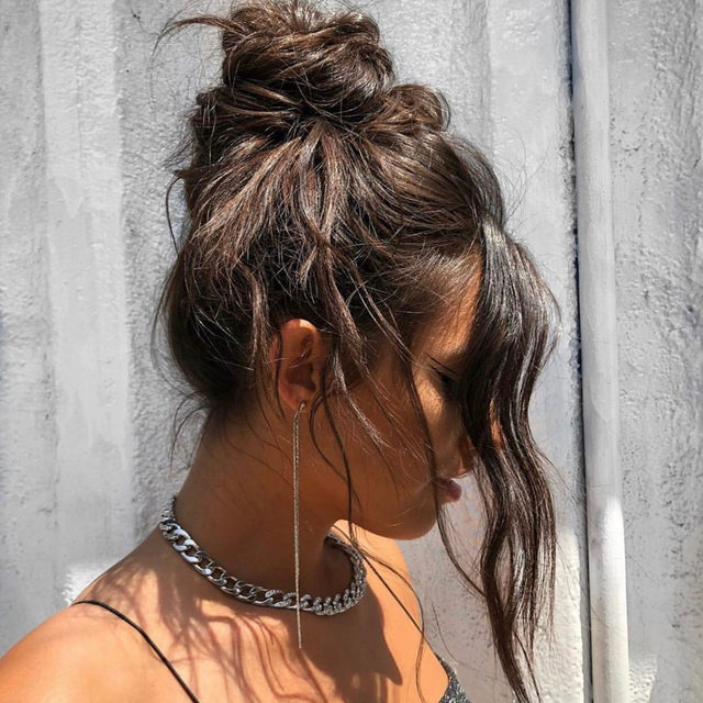 officially on the knotty list 😏 @ashleyantoinebeauty used @theouai's Texturizing Hair Spray to add volume + texture to this perfect, messy top knot - link in bio to shop