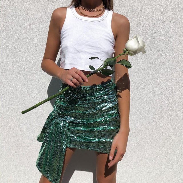 A budding romance | @jacquiealexander in the Madeleine Sequin Skirt  #GIRLSinLOVE #Holiday2019