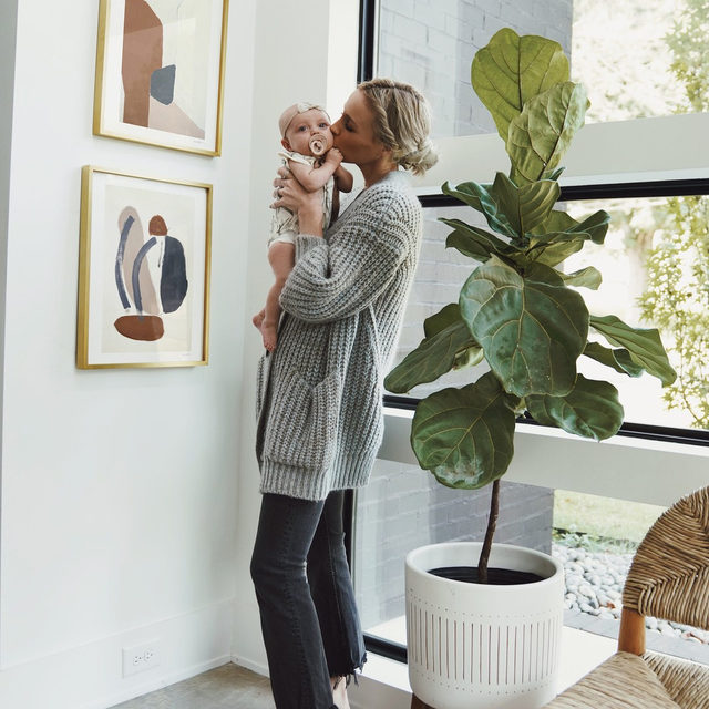 """""""I love having a visual statement on our walls when you walk into our home. Whether it be a gallery wall or a modern minimalist piece, I want our home to feel inviting and warm."""" Nashville-based fashion blogger Mary Lawless Lee of @happilygrey shares her words to live by when it comes to #MintedArt in the home. Link → bio. #NewYearNewHome — """"Terrazzo"""" and """"Tracks No. 3"""" @karaschlabaugh"""