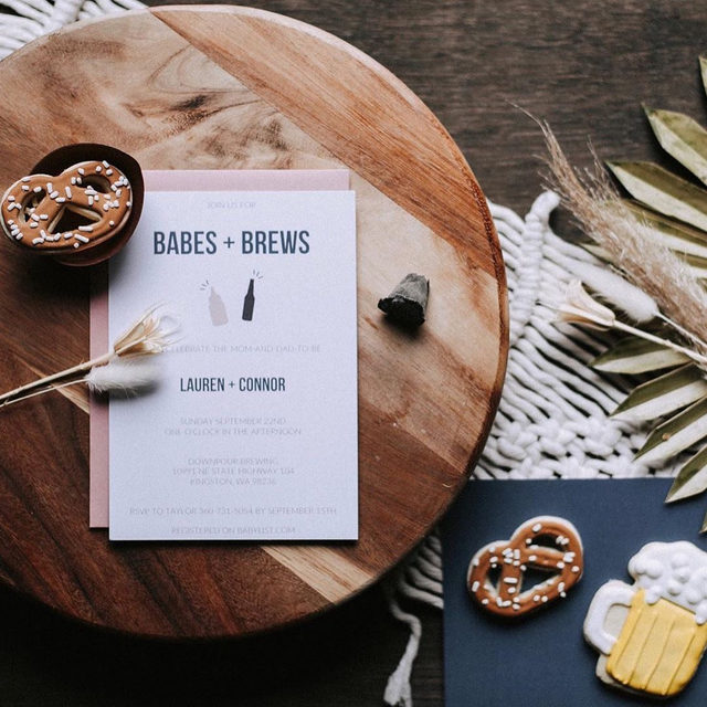 """Babes and brews. 👶 🍻 Swipe through to this fun coed baby shower shot by @bixbyandpine. — """"Babies and Brews"""" baby shower invitation by Amanda Sager."""