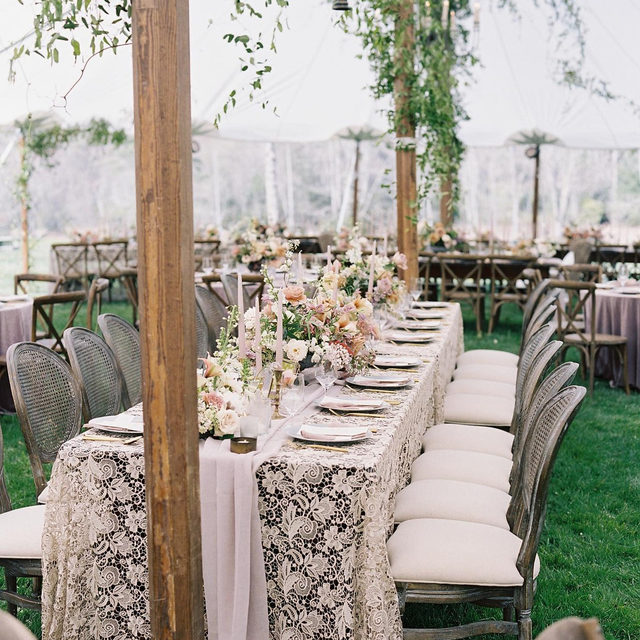Dreamy #headtable with all the texture - a farm table layered with our #venicelacelinen in Cappuccino and #auroralinen table runner in Mauve 🌿🌿 Planning + Design @invisionevents Design concept, styling, creative direction @lacygeary Floral design @kellylenard Photo @clarkbrewer Featured in @martha_weddings #latavolalinen #transformyourtable #lace #lacetablecloth #sheertablerunner #softcolors #romanticwedding #tentedwedding #outdoorwedding #floralchandelier #hangingflorals #hangingflowers #northcarolina #northcarolinawedding #sapphirenc #charlottenc