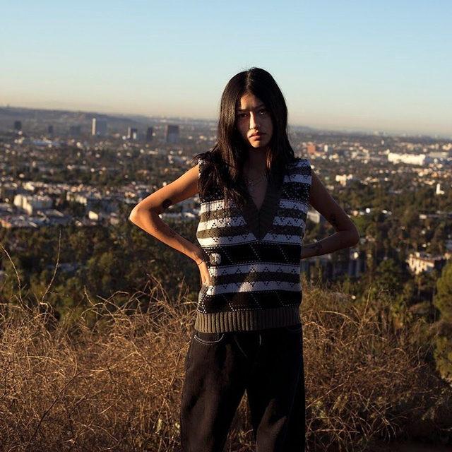 @_babytime98_ wears our knit pattern sequin vest in the Hollywood hills 📷: Shot by @clareshilland in LA #ganni #gannigirls