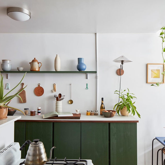 When designer @sophielou_sophielou and @adrianharwood moved into a former Italian restaurant, there surprisingly wasn't much cooking space to work with, but it seemed silly to invest in a real kitchen cabinet for a rental. So they bought IKEA's cheapest unfinished cabinet, painted it, and topped it with plywood and a sheet of @forboflooringsystems furniture linoleum for this chic unit 🛠 See more from their inspiring apartment 👉 link in bio 📸 by @wgeddes ✍️ by @kv.jpg