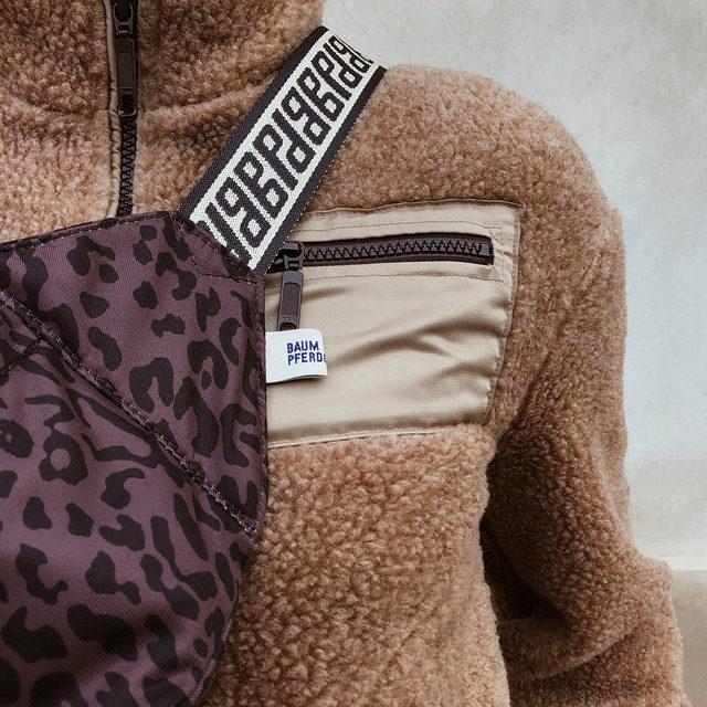 The comfort zone: warm teddy fleece and bum bag in leopard print.  Head to our link in bio to shop now . Romance & Rituals #PS20 #BaumundPferdgarten