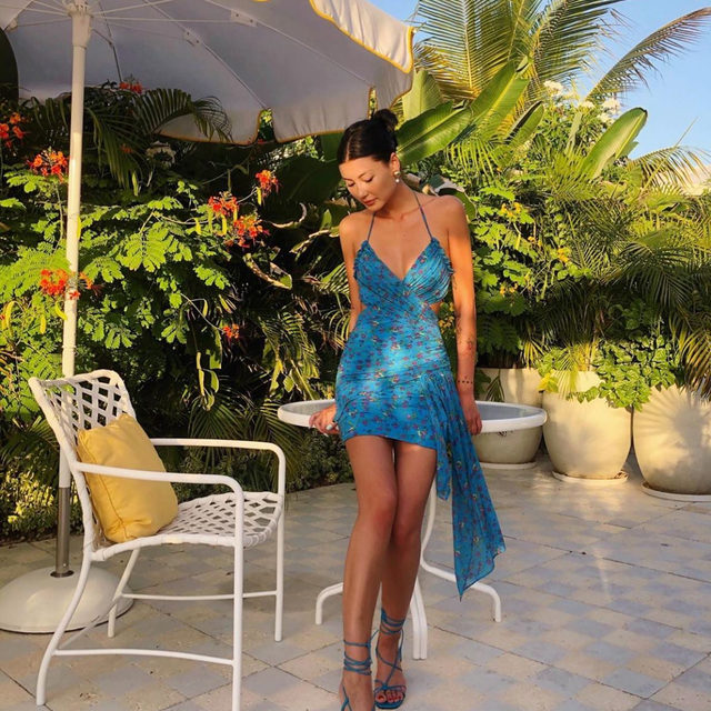 Out of office mood @amalie_gassmann in the Bahama Wrap Dress #GIRLSinLOVE