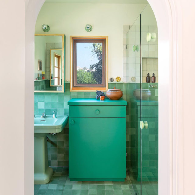 """In the middle of the bathroom floor in her L.A. duplex, @laurelconsuelobroughton placed a single bubblegum pink tile among a sea of jade and sage and seafoam green. """"Old houses have had additions made to them over time, and sometimes these additions are kind of quirky. The pink tile, for me, was a way of putting in a playful detail—but one that also speaks to that sense of change,"""" Laurel explains. See more of the renovated space 👉 link in bio 📸 by @laurejoliet ✍️ by @my_shokoko"""