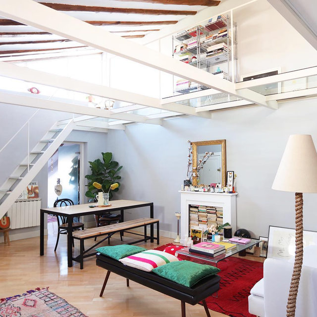 """""""An eclectic cabin in the center of Madrid,"""" is how fashionable twins @helenacuesta and @luciacuesta_ of @thembonesjewelry describe their unique lofted space. And while you might imagine decorating with your sibling to be a nightmare, these two had the best time 👯♀️ See more of their home 👉 link in bio 📸 by @inmarbi"""