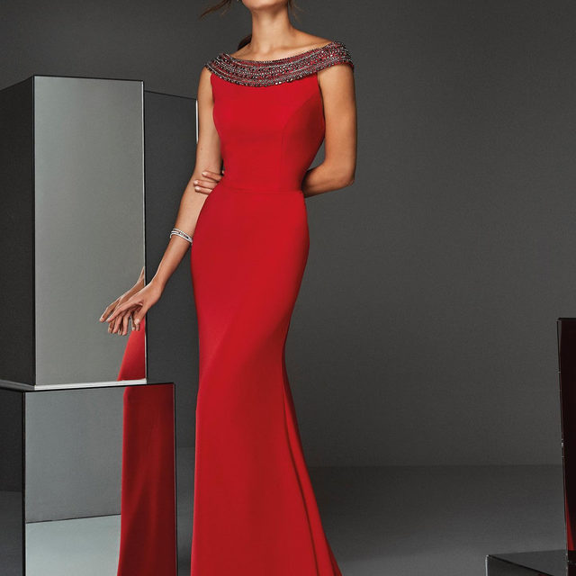 Make an statement in this red party dress with sparkling cross straps in the back. Discover the Atos Style 04 at your nearest Pronovias Store and online. #PartyEdit2020