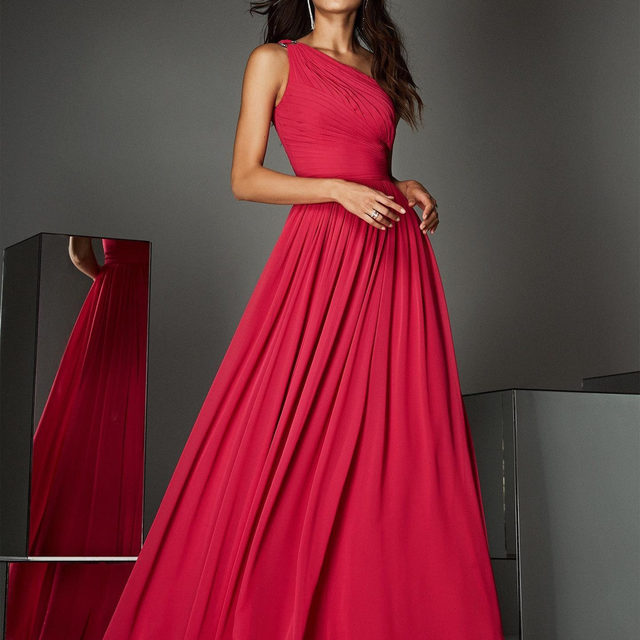 A dream in red chiffon, draped bodice, and one-shoulder neckline. It is the Atos Style 29. Link in bio. #PartyEdit2020