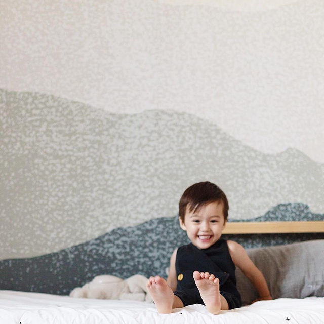 """GIVEAWAY // Refresh their space with a removable kids' wall mural and we're giving one away to a lucky winner. #MintedMural — To enter: ① Follow @minted ② Like + save this post (bookmark button below this image) ③ Tap the link in bio to see the assortment + comment with which mural you'd like to win — Winner will be announced in comments on Mon 2/3. """"Foggy Mountain View"""" by @susannekasielke."""