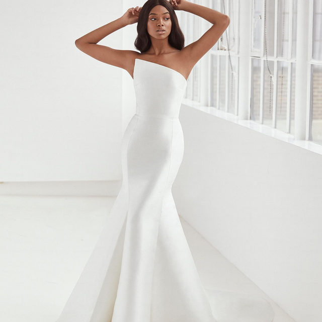 Less is more on this impeccably cut mermaid gown, tailored in glossy Mikado silk. #AshleyGrahamXPronovias Tag a friend who is looking for her dream wedding dress.
