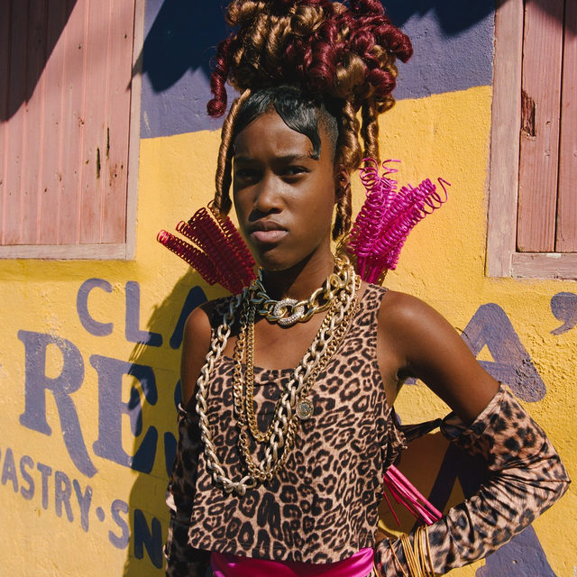"""'Tallawah,' the new collaboration between Jamaican-Nigerian photographer Nadine Ijewere (@nadineijewere) and experimental hairstylist Jawara (@jawaraw), captures """"the pride and strength of the Jamaican people."""" On view in London's Cob Gallery, it's a window into the world of Caribbean glamour, while illuminating the many extraordinary details of everyday people. """"'Tallawah' means 'be strong and fearless,'"""" says Ijewere. """"These are strong women, some with their own stories of struggle, but the way that they hold themselves, the way they express themselves is so inspiring. That's what this project embodies."""" Tap the link in our bio for more. Photo: @nadineijewere"""