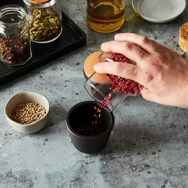 """File this under """"little kitchen helpers making a big impact."""" With just a couple twists, this cast-iron grinder delivers freshly ground spices—just like that. And see that beech wood lid? It pops off and stores the extras for later (you know how we love a multi-tasker 🙌). Shop for yours at the link in bio. 📸: @rockyluten"""