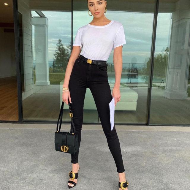 OFF DUTY 101 | @oliviaculpo in her @grlfrnd jeans + the @versace buckle heels - link in bio to shop