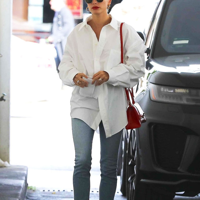 "A classic button-down shirt makes for a simple but brilliant fit—take @haileybieber's look as proof. The ""boring"" trend is set to be a major staple for spring. Tap our link to get the look yourself. photo: backgrid"