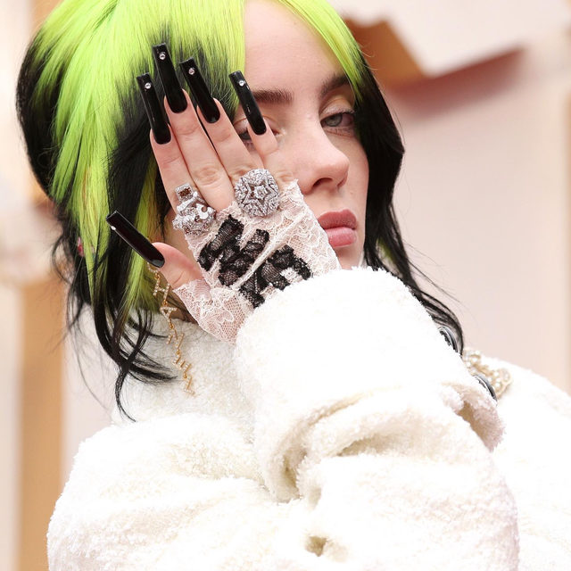 Queen of co-ords #BillieEilish upped the ante for her first #Oscars, putting an emo spin on the classic @ChanelOfficial bouclé suit. #Chanel worked within the parameters of Eilish's style to create a two-piece suit unlike anything its petites mains had witnessed on the atelier work benches before. With no fewer than five interlocking C badges pinned to her cream bouclé jacket-cum-bomber, another woven through her hair with a Chanel ribbon, and chunky diamond jewellery, the effect was truly individual. Click the link in bio for everything you need to know about her look for the #Oscars2020.