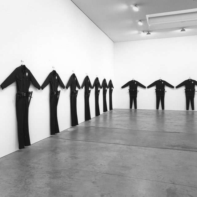 "#GagosianViewingRoom: Chris Burden's powerful and politically charged oversize ""L.A.P.D. Uniform,"" which reflects on the Rodney King trial and the Los Angeles riots of 1992, is included in Gagosian's Frieze LA Online Viewing Room.  Created in 1993, the work is one of thirty larger-than-life replicas of the L.A.P.D.'s standard wool uniform, each equipped with a regulation belt, holster, baton, handcuffs, 92F Beretta handgun, and meticulously copied police badge. Burden's ""L.A.P.D Uniforms"" serve as commentary on the complicated relationship between the public and authority even today.  Gagosian was the first to exhibit ""L.A.P.D Uniforms"" in 1994, less than two years after the incidents that inspired it. The show marked an important and particularly political period in Burden's career that was reflective of the social unrest across the nation at the time. In 2000–01, all thirty uniforms were exhibited in ""Made in California: Art, Image, and Identity, 1900–2000"" at the Los Angeles County Museum of Art. The first"