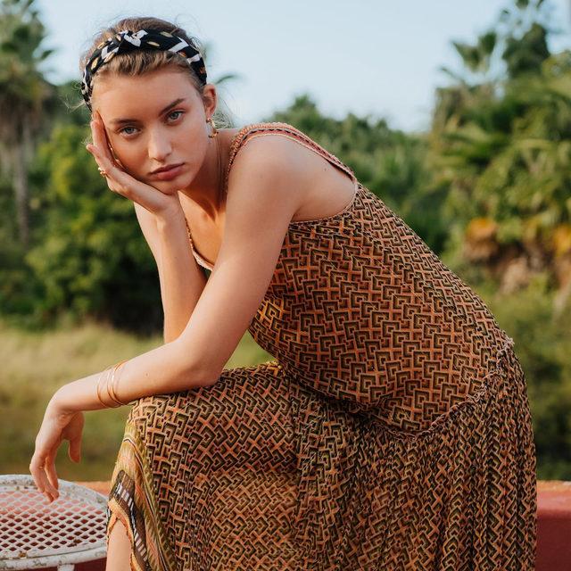 Glimmering metallic threads make the Katya Midi Dress  shine in the sun 🌤 (link in profile to shop)