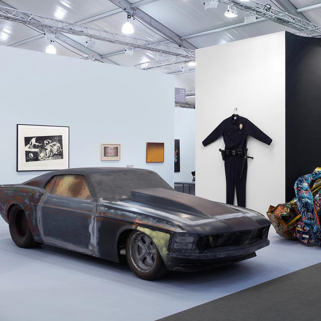 "#FriezeArtFair: Visit Gagosian's booth at Frieze Los Angeles to see ""How to Shrink L.A.,"" a presentation exploring the transformation of car culture from a metaphor for freedom and possibility to a symbol of violence and stagnation.  Taking Los Angeles's system of highways as a literal and figurative backdrop, the selection includes Richard Prince's full-scale car sculpture ""Untitled"" (2008) and Chris Burden's ominously oversize ""L.A.P.D. Uniform"" (1993). The presentation also includes works by Jean-Michel Basquiat, John Chamberlain, Urs Fischer, Theaster Gates, Piero Golia, Alex Israel, Sally Mann, Adam McEwen, Cady Noland, Sterling Ruby, Ed Ruscha, Taryn Simon, Robert Therrien, Andy Warhol, Tom Wesselmann, and others.  To receive a PDF with detailed information on the works in the booth, please contact the gallery at inquire@gagosian.com or via direct message.  __________ #FriezeLA #Gagosian @friezeartfair  Installation views, ""Frieze Los Angeles 2020: How to Shrink L.A.,"" booth C06, Frieze Los Angeles, Feb"