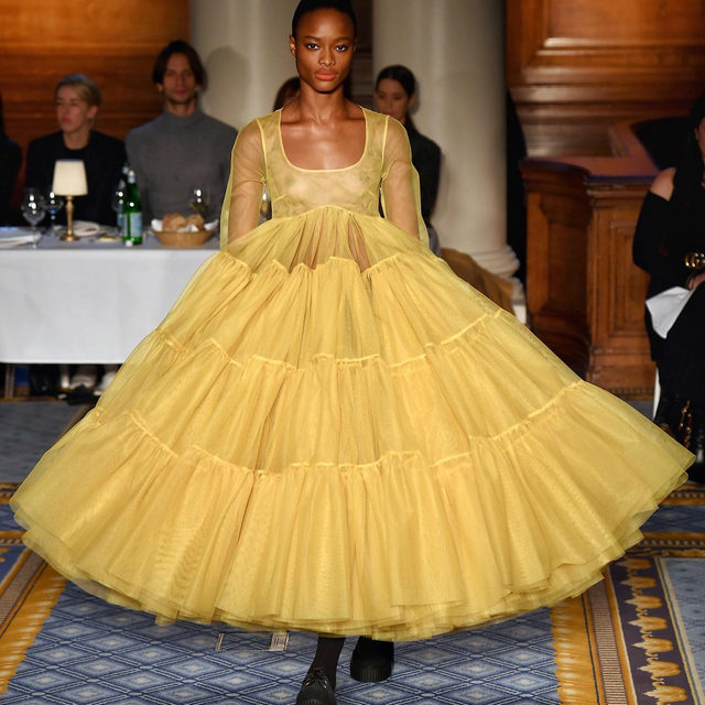 "The news at #MollyGoddard? The queen of tulle is launching menswear - in typically offbeat fashion. ""We basically made one suit,"" she told #BritishVogue backstage, in signature modest style. Discover every frou-frou look - and some suiting, too - at the link in bio."