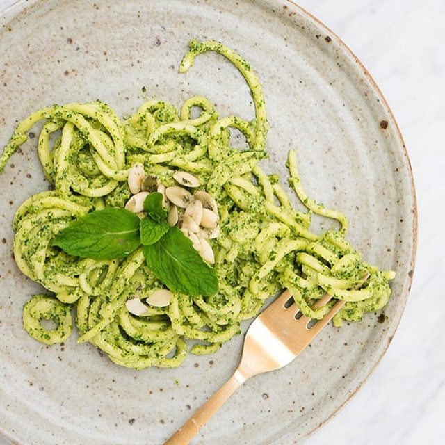 This is a meal that will please even the pickiest of palates. If you don't have a spiralizer, simply prepare one serving of brown rice noodles and shave one zucchini into them before covering with sauce. #goopRecipe (from @lizmoody) below:  Spiralized Zucchini Noodles with Mint Parsley Pepita Pesto 1. Using a spiralizer, create long ribbons with your zucchini. 2. In a food processor or blender, pulse together all pesto ingredients. 3. Toss with a generous coating of pesto (reserve any leftovers for future use).