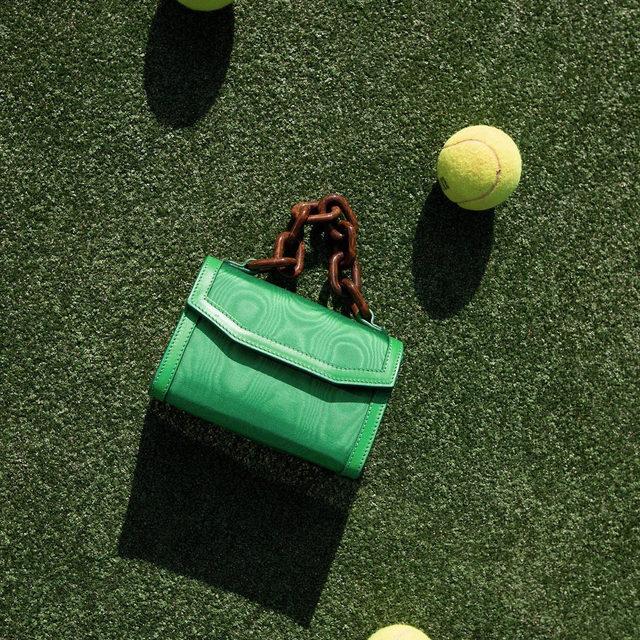 Our SS20 chain handle mini bag doubles up as belt bag #GANNIDOUBLELOVE #ganni