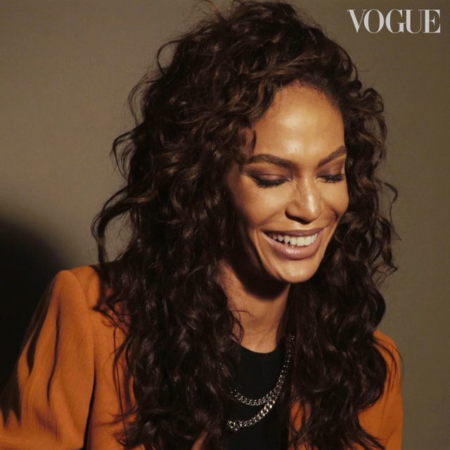 "What's the first thing you do when you wake up in the morning? If it's check your phone, you could probably learn something from #JoanSmalls. Watch as the Puerto Rican supermodel shares her ""firsts"" with #BritishVogue; from the first artist on her current playlist, to the first thing on her mind after a big night out. Watch the full film via the link in bio.  Directed by @MattEaston, DoP @RuslanPelykh and styled by @DenaGia, with hair by @PanosPHair, make-up by @ErinParsonsMakeUp, nails by @LollyKoonNails and produced by @HonorHellonProd."