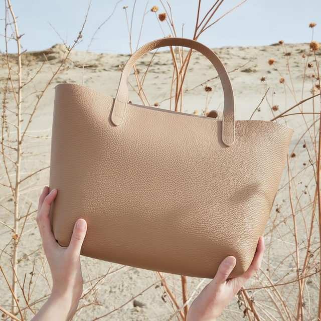 Your work bag, weekend bag, and on-the-go companion all in one. Meet our Small Structured Tote in Cappuccino.