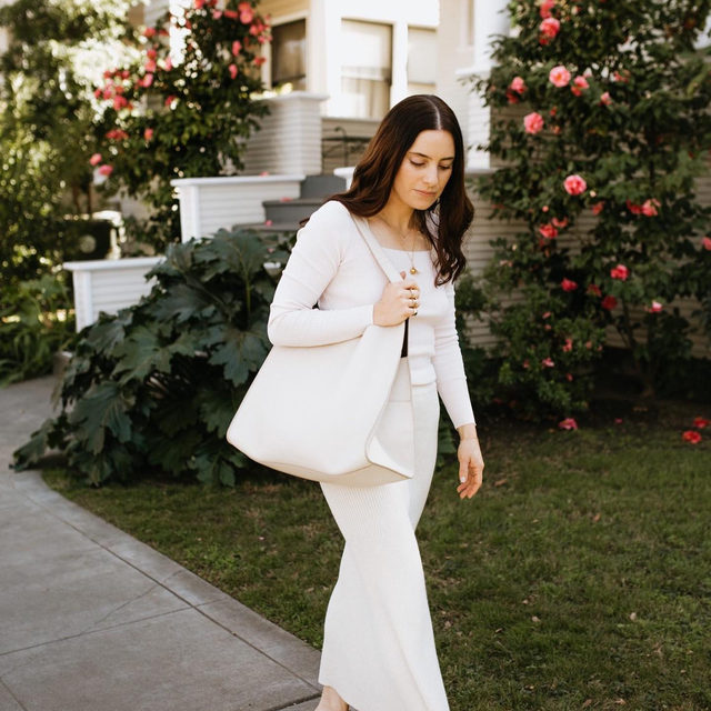 """@aliciamlund in head-to-toe tonal Cuyana . """"A go-to look of mine as we transition into warmer temps has always been to pull out all of the white from my closet as it feels forever fresh and timeless (no matter how long said pieces have been hanging in your closet). Thanks to a few warmer days this week, I've been so happy to be enjoying the sunshine in these lighter hues again!"""""""