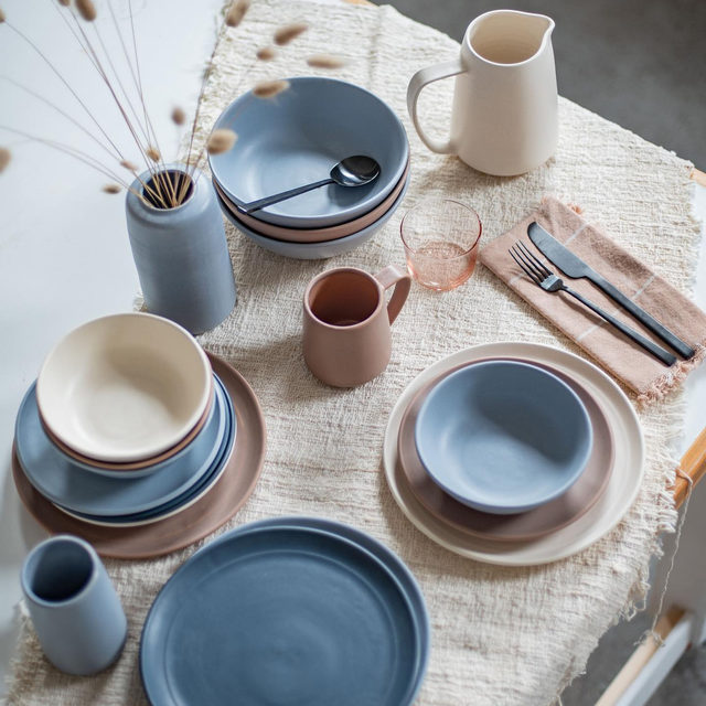 """Meet Abigail Smallwood, co-founder of @myrthceramics. As a small-batch ceramicist, Abigail approaches her work with intention and care: """"Fewer, better is also in our ethos. Our ceramic wares are designed for everyday use, yet are intended to last lifetimes. To create enduring products, we have chosen to work exclusively with porcelain. We also keep our line very small, with items that are classic, timeless, or multi-functional."""" Link in bio for @myrthceramics' story. // Abigail wears our Alpaca Off-The-Shoulder sweater in Ecru. #cuyanacraftswomen"""