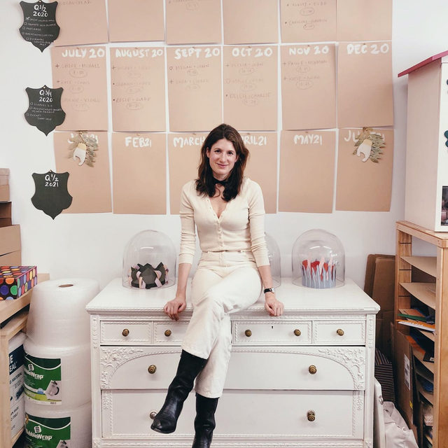 """Meet @happymenocalstudio. A watercolor artist known for her whimsical scenes and custom emblems, Happy has a unique and recognizable style—think dancing florals, unexpected color palettes, and bespoke creations. When asked what she is most proud of in her career, Happy shares that her team of women is her greatest success yet: """"I am relentlessly making things, but my real achievement was assembling my team. I could not love them more. Every idea is improved when we execute it together."""" // Happy wears our Cotton Cashmere Ribbed Cardigan in Ecru. Link in bio for her story. #cuyanacraftswomen"""