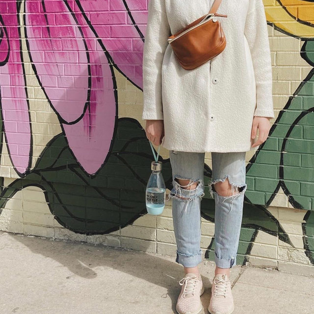 @windythrifty shows us how to dress for the in-between days that aren't warm or cold. Our favorite part of her outfit might be the reusable water bottle. Tap to shop current pieces that will get you through this not quite winter, but not quite spring.