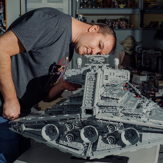 Charles Anderson's Star Destroyer stretches almost 5 feet long, but opposite the enormity is an attention to detail—the filigree of LEGO figurine hands ringing the docking bay; the barnacle-like swath of pipes that make up the vents, pipes, and cannons—that makes the ship an artistic, architectural marvel. 🔗 Check out the link in our bio to learn more about this 20,000 piece LEGO Star Destroyer. 📸:@colewilson