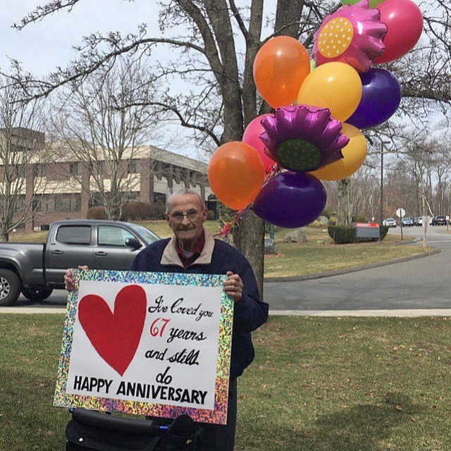 """I've loved you 67 years and still do."" ❤️ Coronavirus stopped Bob from being able to enter his wife's nursing home on their 67th anniversary, but it didn't stop him from standing outside her window with balloons and this sign! 😭 Head to the #linkinbio for what else he had to say. 