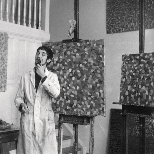 """#GagosianQuarterly: To learn more about Georg Baselitz, head to """"Gagosian Quarterly"""" to read a piece by Richard Calvocoressi, in which he traces the artist's early education in East Germany to his revelatory trip to Florence, in 1965, and beyond. The article was written on the occasion of the artist's career-spanning exhibition at the Gallerie dell'Accademia, Venice, last year. Follow the link in our bio.  __________ #GeorgBaselitz #Gagosian @gallerieaccademiavenezia Hans-Georg Kern (Georg Baselitz) standing in front of his own tachist paintings, Hann Trier's class, Hochschule für bildende Künste, Berlin, c. 1957–58. Photo: Courtesy Archiv Georg Baselitz"""