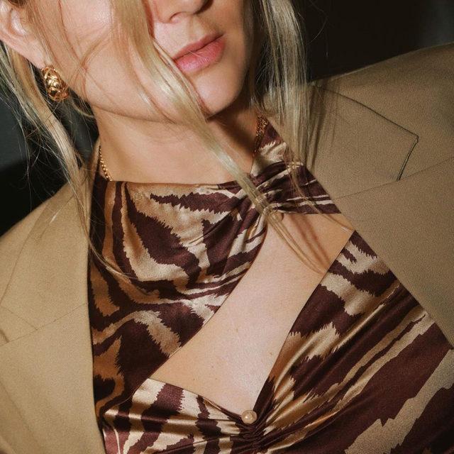 Homebody, but make it fashion @lucywilliams02 wears our silk stretch satin blouse 🍩 #GANNIGirls #GANNIWFH