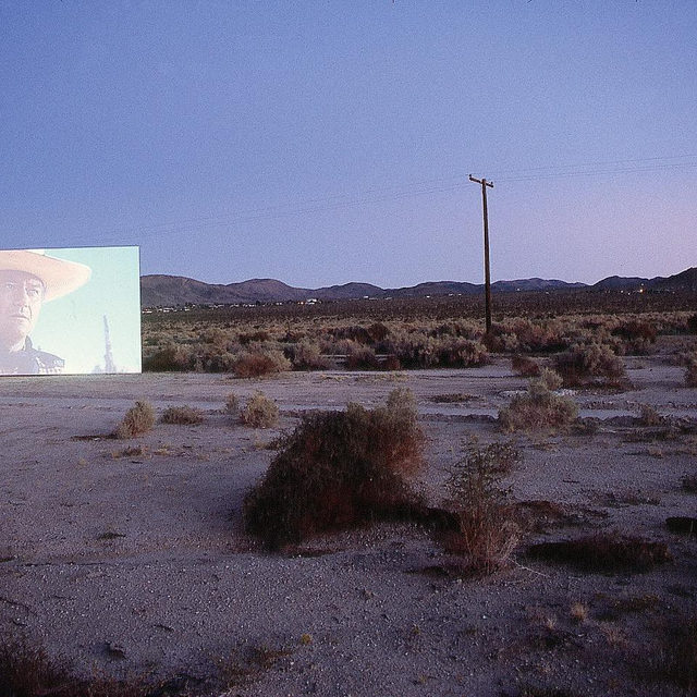 """#GagosianQuarterly: Experimenting with temporal manipulation in his films and videos, Douglas Gordon uses both his own work and that of others as raw material to distort time, disorient, and challenge the viewer.  In 1995, Gordon developed the film """"5 Year Drive-By,"""" which draws out John Ford's legendary 1956 Western """"The Searchers"""" to match the duration of the search referenced in the film's story. It sets up a real-time experience of the time frame the film depicts. In this instance, one second of cinema time equates to 6.46 hours in real time, or an incredible three frames per hour, meaning that even the most dedicated of viewers is unlikely to ever see more than a few seconds of the original film. Follow the link in our bio to read more about Gordon's work on """"Gagosian Quarterly."""" __________ #DouglasGordon #Gagosian Douglas Gordon, """"5 Year Drive-By,"""" 1995, single projection work, 5 years, loop © Studio lost but found/VG Bild-Kunst, Bonn 2018. Photo: Kay Pallister"""