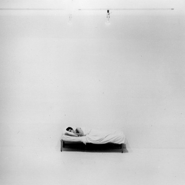 """#StayHome: From his action-based works of the 1970s to the jaw-dropping technical feats of his later sculptures, Chris Burden consistently challenged his mental and physical limitations, reflecting on the surreal and precarious realities of contemporary life. Burden was interested in the staging of spectacle and the ways in which art could complicate one's understanding of the material world.  In his 1972 work """"Bed Piece,"""" Burden placed a single bed in the gallery space of 72 Market Street in Venice, California, and lived in it for twenty-two days, turning a usually private object into a public stage. Read more about Burden's work via the link in our bio.  __________ #ChrisBurden #Gagosian  Chris Burden, """"Bed Piece,"""" 1972. Performance at 72 Market Street, Venice, California, February 18–10, 1972 © Chris Burden/Licensed by the Chris Burden Estate and Artists Rights Society (ARS), New York"""