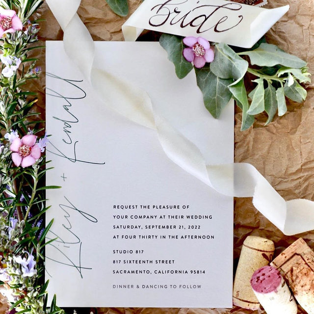 """#MintedWeddingPlanner @oathanddream's thoughtful flat lay, incorporating unique elements like vintage stamps, and wine corks from the big day.  __ """"printed"""" wedding invitation by @joann_jinks Planning, Design + Photography: @oathanddream   Florals: @simplyserrafloral   Ribbon: @nettle_and_silk   Styling Accessories: @stylingmat"""
