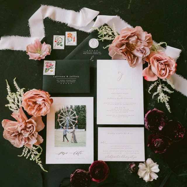 "Full of special touches with feathery ribbon, antique stamps and bountiful  blooms 🌸  __ ""Classy Date"" save the date design by Bethany McDonals Photo: @lauramollphoto   Styling: @tylerspeier . . . #engaged #weddingideas #weddinginspiration #weddingdetails #weddingphotography #weddingplanning #weddingflatlay #justengaged #thatsdarling #pursuepretty #theknot #sayido #howtheyasked #marthaweddings #weddingseason #engagementseason #weddingplanner #weddinginvites #savethedate #weddinginvitation #flatlay #invitationdesign #modernwedding"
