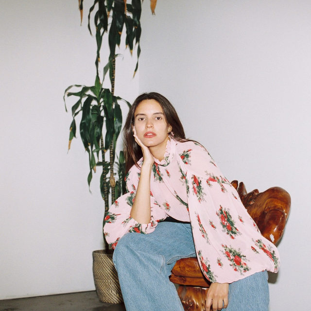 🌺🌷🌹🌸🌹🌷🌺 @danaboulos in our pleated floral blouse + made from 100% certified recycled polyester + Read more about our journey into switching to responsible materials over @ganni.lab #GANNI #GANNIGirls
