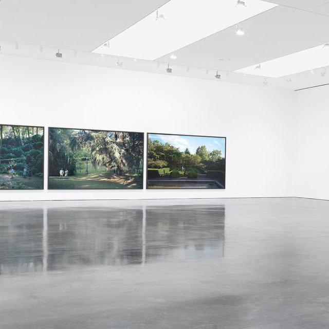 """#FromTheArchive: """"Strange to think that an exhibition seen as recently as last summer should already be the stuff of archive and memory.  Having spent the closing weeks of Jeff Wall's first Gagosian exhibition in the hosting Chelsea gallery, I realized that what at first seemed a powerful gathering of recent images, was in fact a profound, lyrical, and coherent meditation on the nature of paradise.  Some subjects were instantly apparent. Elaborately staged in a celebrated Italian garden, Wall's great cinematic triptych 'I giardini' was explicit. Paradise lost indeed. So too was the astonishing image of paradise regained, 'Recovery.' This glorious panorama, filled with photographic and painted paradox, evoked earlier arcadias of Gauguin, Seurat, and Titian. Memories of childhood represented other kinds of paradise, both found and lost—found in 'Parent child''s sun-filled street scene, and lost in the mystery and imagination of 'Mother of pearl.'  The rules of the game become clear. The play is endless in a fie"""