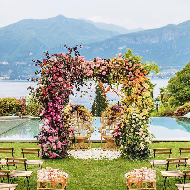 This couple had the most magical wedding ceremony we've ever seen and it wasn't even their only one! ✨✨ Their second ceremony was just as dreamy and we have all the inspiring photos waiting at the #linkinbio. 🌈#BridesRealWeddings 📸: @rossharvy 📋: @lakecomoweddings 💐: @tulipinadesign