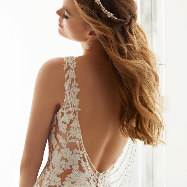 In #love with the delicate chandelier back #detail on our Alessia #gown! 😍 Swipe for a look at the #beautiful train ✨ . . . #morilee @madelinegardner #madelinegardner #chic #designerweddingdresses #weddingdesigner #bridal #bridalgown #instawed #weddingseason #realweddings #weddedbliss #weddingshoot #bride2019 #realbride #sayyestothedress #isaidyes #bride2be #pride #love #bridalgowns #bridalgown #modernbride #classicbride #dresscometrue #2020wedding #romantic #brides