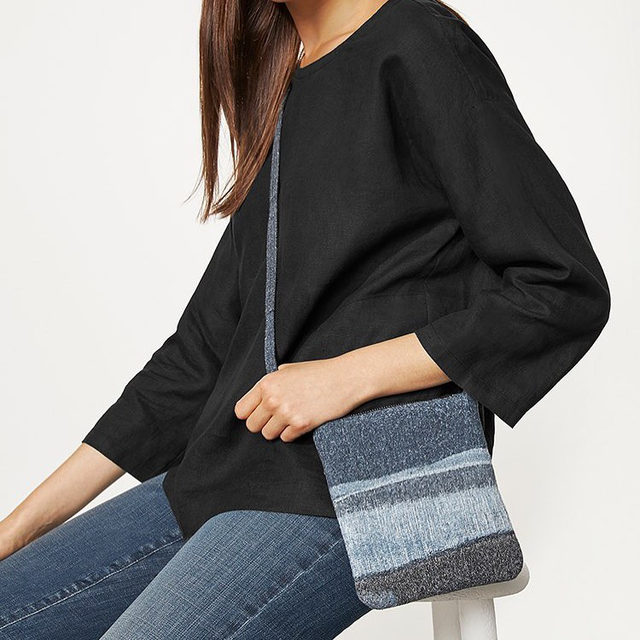 The perfect little weekend bag: the @wastenomore Denim Crossbody Bag, made with clothes from our Renew take-back program that have been felted into one-of-a-kind designs. Where others see waste, we see possibility. #CircularByDesign